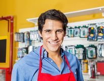 Handsome Worker Smiling In Hardware Shop. Portrait of handsome young worker smiling in hardware shop Royalty Free Stock Photography