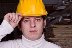Handsome worker in yellow helmet at warehouse Stock Photo