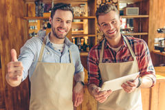 Handsome workers at cafe royalty free stock image