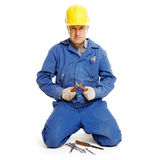 Handsome workman sitting against white Stock Images