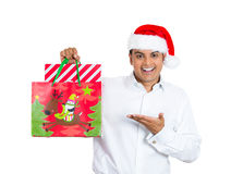 Handsome xmas man smiling and excited about his festive bag Stock Image