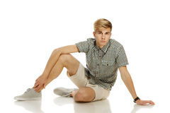 Handsome youn man sitting on the floor Stock Photography