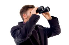 Handsome young accountant with binoculars Stock Photography