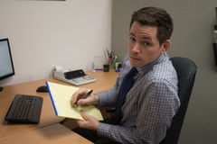 Handsome Young Accountant Working at Office Royalty Free Stock Photography