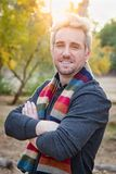Handsome Young Adult Male Wearing Scarf Portrait Outdoors. Vertical - Handsome Young Adult Male Wearing Scarf Posing for a Portrait Outdoors stock image