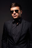 Handsome young adult man in sunglasses Royalty Free Stock Photography