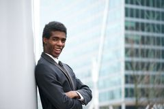Handsome young african american businessman smiling in the city Royalty Free Stock Photography