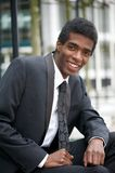 Handsome young african american businessman smiling Royalty Free Stock Image