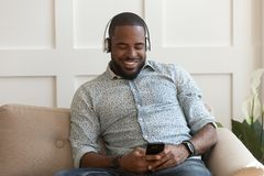 Free Handsome Young African American Guy Wearing Wireless Bluetooth Headphones. Royalty Free Stock Photos - 157773838