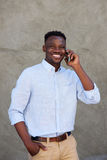 Handsome young african american man making a phone call Royalty Free Stock Image