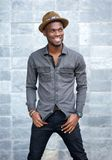 Handsome young african american man smiling with hat Royalty Free Stock Photo