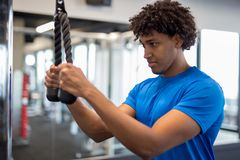 Handsome young african american man working out at the gym stock photos