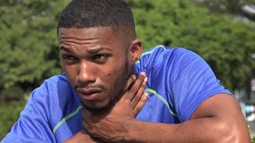 Sick Black Male Athlete Choking. A handsome young African American stock video footage