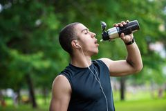 African american sportsman drinking water Stock Images