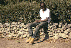 Handsome young african man outdoors in summer Royalty Free Stock Photos