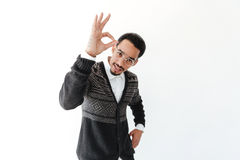 Handsome young african man showing okay gesture. Picture of handsome young african man isolated over white background. Looking at camera showing okay gesture Stock Image