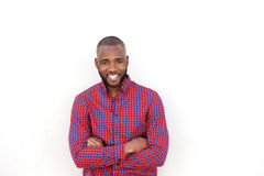 Handsome young african man smiling with arms crossed by white wall. Portrait of handsome young african man smiling with arms crossed by white wall Stock Photography