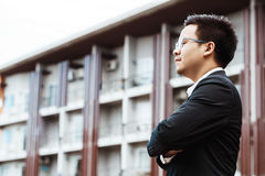 Handsome young asian Business Investor with arms crossed standin Royalty Free Stock Images