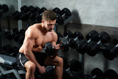 Handsome young athlete working out at the gym stock photo