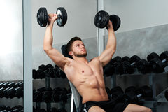 Handsome young athlete working out at the gym royalty free stock photo