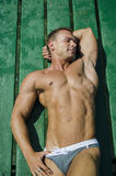 Handsome young, athletic muscle man on pier Royalty Free Stock Photography