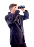 Handsome young attorney with binoculars Stock Images
