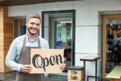 Handsome young barista is advertising his Royalty Free Stock Photo