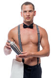 Handsome young barman with shaker in hand Royalty Free Stock Photos