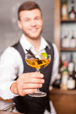 Handsome young barman is working in bar Royalty Free Stock Photography