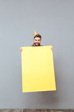Handsome young bearded birthday man holding copyspace board jumping Stock Photography