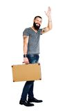Handsome young bearded man holding a suitcase royalty free stock photo