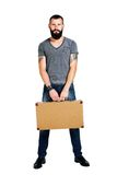 Handsome young bearded man holding a suitcase royalty free stock images