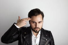 Handsome Young Bearded Man Wearing Stylish Shirt Black Leather Jacket Shot Hand Head.Beauty,Lifestyle,People Concept Stock Photo