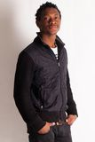 Handsome young black guy posing Stock Photography