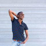 Handsome young black guy smiling with hand behind head Royalty Free Stock Photos
