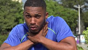 Black male athlete choking. A handsome young black male stock video footage