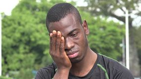 Tearful African male athlete. A handsome young black male stock footage