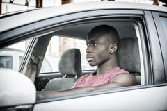 Handsome Young Black Man Driving a Car Royalty Free Stock Photos