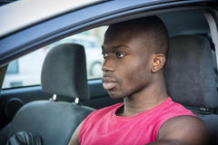 Handsome Young Black Man Driving a Car Royalty Free Stock Photography