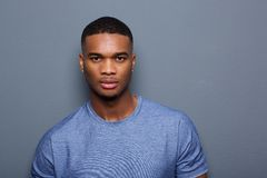 Handsome young black man with serious expression on face. Close up portrait of a handsome young black man with serious expression on face stock photography
