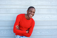 Handsome young black man smiling with arms crossed Stock Photos
