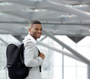 Handsome young black man smiling with bag Royalty Free Stock Photo