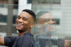 Handsome young black man smiling Royalty Free Stock Photos