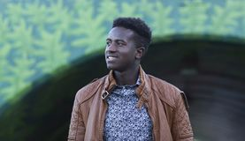 Handsome young black man smiling in front of an underpass Royalty Free Stock Image