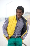 Handsome young black man smiling outdoors Stock Photos