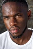 Handsome young black man with sweat dripping down face Royalty Free Stock Images