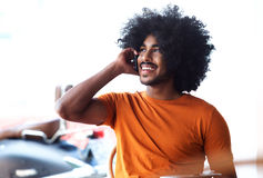 Handsome young black man talking on cell phone Stock Photo