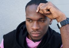 Handsome young black man thinking Royalty Free Stock Photography