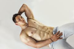 Handsome young bodybuilder laying down on floor Royalty Free Stock Photography