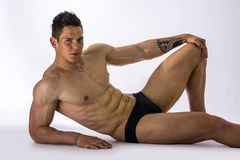 Handsome young bodybuilder laying down on floor Royalty Free Stock Image